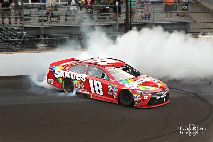 July 24, 2016: Kyle Busch (18) burns out after winning the Combat Wounded Coalition 400 at the Indianapolis Motor Speedway in Indianapolis, IN <a class=